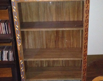 Glass front bookshelf, or pharmacy cabinet.