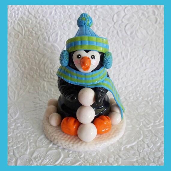 Petey Penguin Figurine he has a terra cotta pot body base
