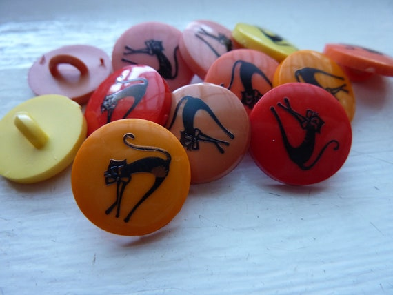 Cool for cats. 12 hip and funky black cat buttons for good luck. Yellow, orange, pink, red