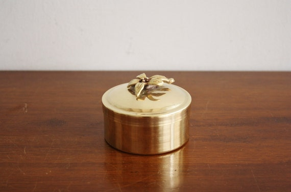 Vintage brass box with decorative flower finial