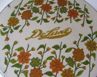 vintage fruitcake tin DeLuxe Brand with floral needlepoint design