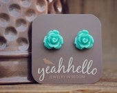 teal parade rose flower earrings by yeahhello