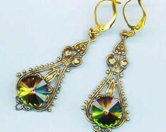 Iridescent Green Rivoli Swarovski Crystals . Statement Earrings . Brass Rhinestone Dangle . Victorian - Dancing by enchantedbeads on Etsy