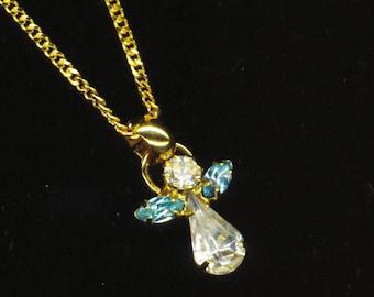 Vintage Angel Pendant . Clear Blue Crystal . Birthstone . Aquamarine Rhinestones . Gold Plated Chain - Bright Angel by enchantedbeas on Etsy