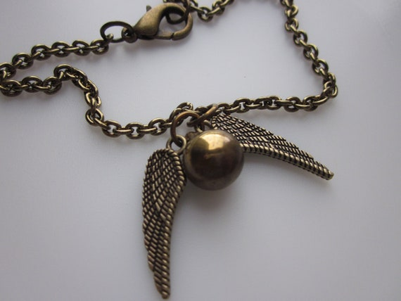 Gold Flying Orb Charm Bracelet, Golden Winged Ball Charm Bracelet