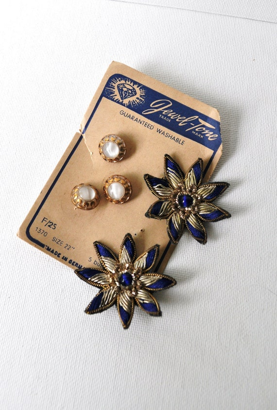 A Pair of Metallic Bullion Appliques Blue and Gold Foil and Three Pearly Gold Luster Buttons