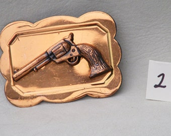 vintage copper western pistol or revolver belt buckle  2 of a pair