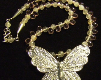 Butterfly w/ old world filigree surrounded by Rutilated Quartz and Pink Czech glass then Finished off by a stylish Sterling S-Hook Clasp