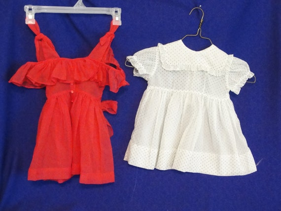 Two vintage little girls dresses Sheer crinkly fabric One red One white with blue dots