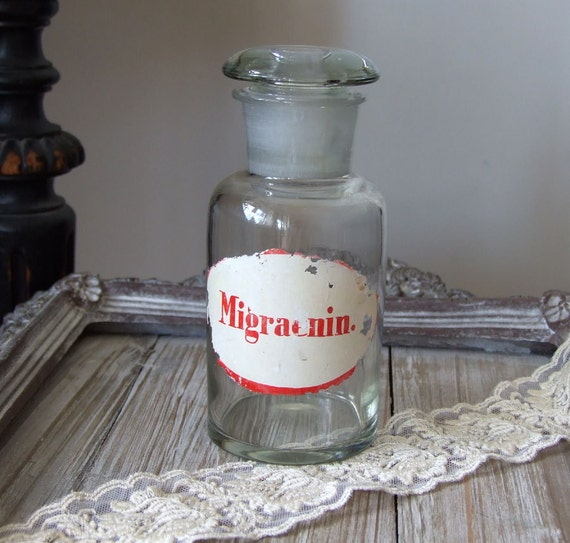 Vintage  APOTHECARY bottle jar, large pharmacy bottle  clear glass with etched lid and painted label Migraenin
