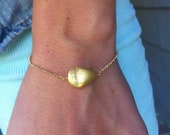 chain bracelet with brushed gold bead