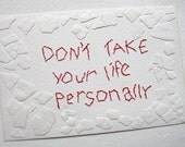 Don't Take Your Life Personally: mixed media w/threaded text message on paper