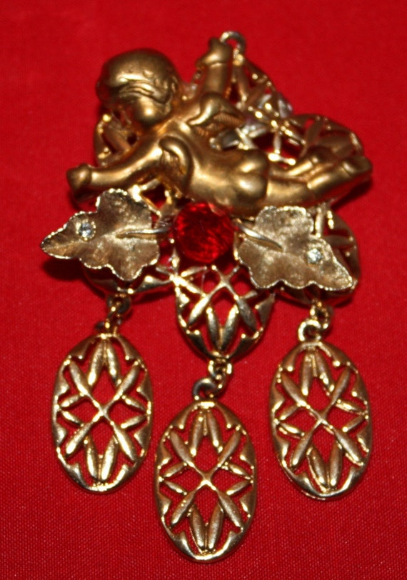 Vintage Brooch, Angel or Cupid on a Golden Flower with Red Glass Stone and White Rhinestones