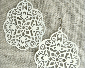 Large filigree dangle earrings.  Cream color with antique brass hooks.  Shabby chic jewelry by Sweet And Simple.