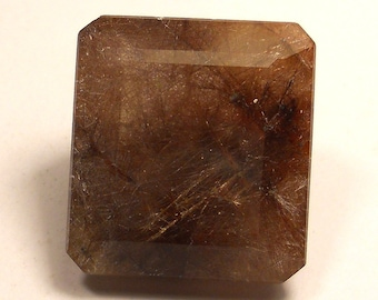 74.5 carat  ...  faceted rutilated quartz gemstone ... 27 X 25 X 15 MM