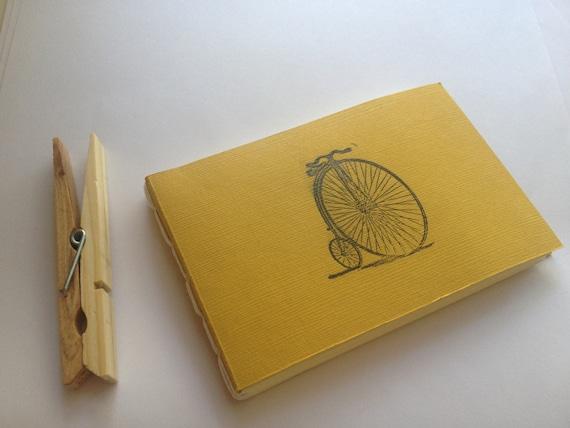 small yellow bicylce journal
