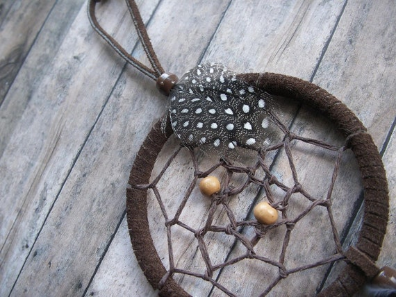dark brown dream catcher with mixed feathers