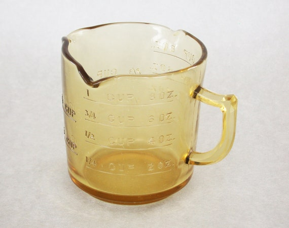 Antique Amber Glass Embossed Three Spout Measuring Cup 3.5 Inches Tall