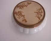 White dish with metal lid