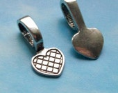 20 heart shaped glue on bails, slightly antiqued silver tone, 21mm