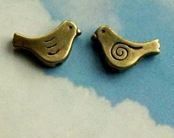 SALE - 10 bird spacer beads with swirly wing, bronze tone, 15mm