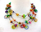 Short three tired necklace using very colorful resin and seed beads.