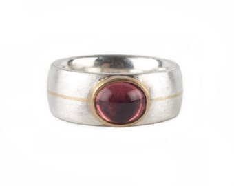 ring with pink tourmalin and golden stripe