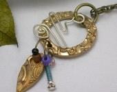 Leaf falling bronze necklace