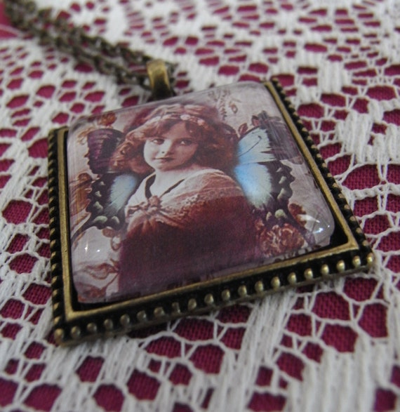 vintage ephemera altered art, sepia child with butterfly wings, pendant necklace, Sepia Song by Starzyia