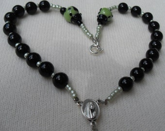 Auto Rosary Black beads with Laldybugs  in Black and Green Silver Crucifix Tiny Silver Middle Medal Clasp for Easy on and Off Custom