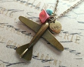 Love Travel. Airplane Pendant with Love Charm and Flower Necklace.
