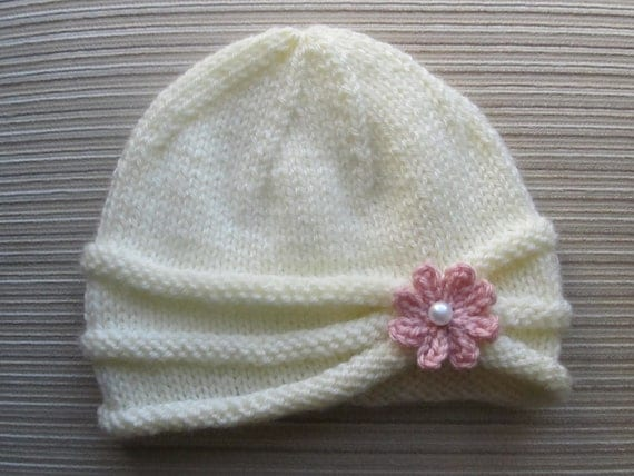 Number 86 PDF Knitting Pattern Girls Hat with Rolled Brim and a Flower in sizes 6-9 months and 2-4 years