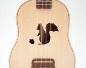 Ukulele (customizable sound hole of choice) Example: Squirrel