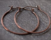 Large urban flirty continuous copper hoop earrings
