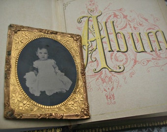 Antique tintype of baby girl, ornate gold frame, larger size, lovely antique
