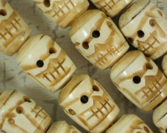 10 Spooky 26mm Skull Beads Carved Antiqued Bone kinda Cartoon like (5401 -10)