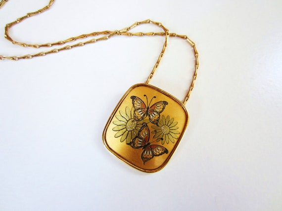Vintage gold necklace. Butterfly pendant. Daisy flowers. Retro and pretty. Flower power. Amber and orange damascene