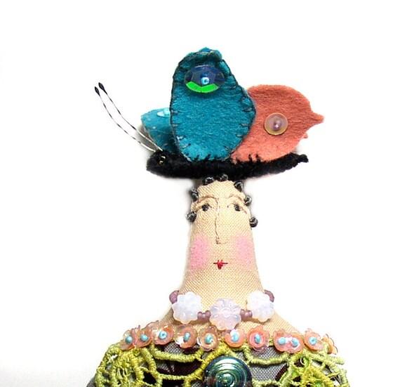 Textile art handmade cloth art doll with a felt butterfly on top of her head