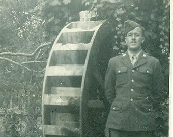 WW2 Soldier Standing Next To A Water Wheel Grist Mill World War 2 Uniform Vintage Photo Photograph