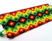 Mexican Bracelet Colorful. Green reds yellows and blacks. huichol  Handmade craft. Traditional.
