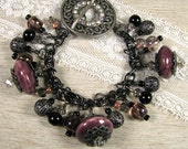 "Charm Bracelet With Black and Gunmetal ""Beautiful Baubles"""