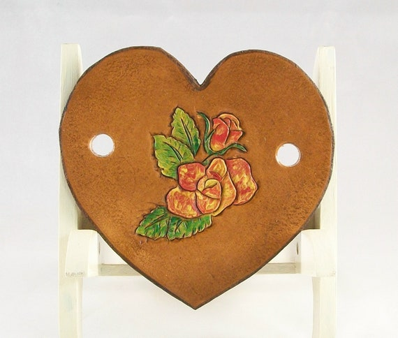 Hand painted red and yellow roses on a leather barrette