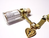 Love Song in a Bottle Keychain. I Will Wait by Mumford and Sons. Gold Love Heart Charm. Valentine's Day Under 25 dollars