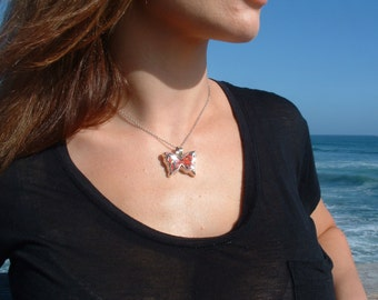 Sterling silver butterly pendant with huairuru seeds and liquid glass upscale organic
