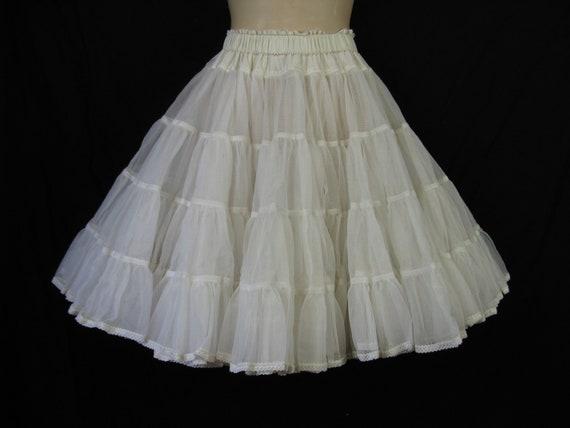 1950's white petticoat.  tons of ruffles crinoline. tulle full circle skirt.