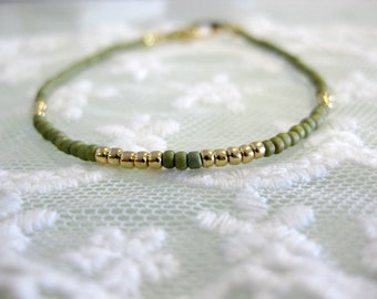 Dainty moss green and gold friendship bracelet for everyday. Minimalist everyday simple jewelry.