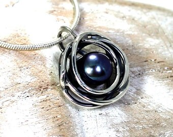 Pendant with twisted swirl wire and white or black pearl , 5-6 mm freshwater pearl and sterling silver