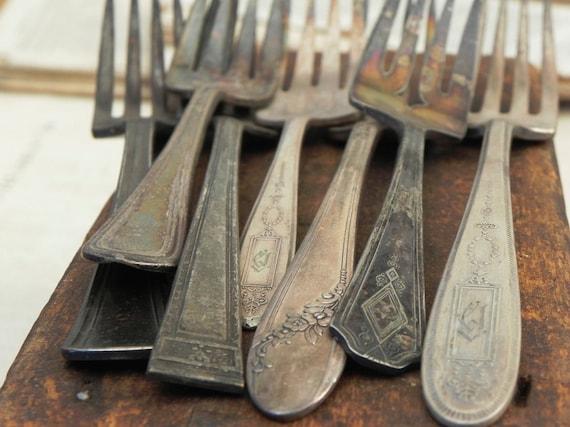 7 vintage silver plated forks