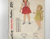 Vintage 50's Girl, Child's dress sewing pattern.   Simplicity.  Size 4.   No. 1785.