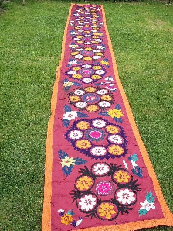 15 feet long  Bright hand embroidered Zardevor Suzani from Uzbekistan. Wall hanging.